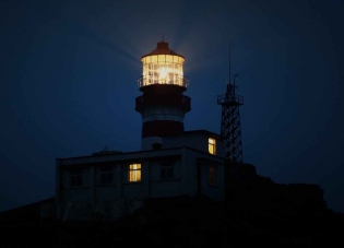 lighthouse during night time